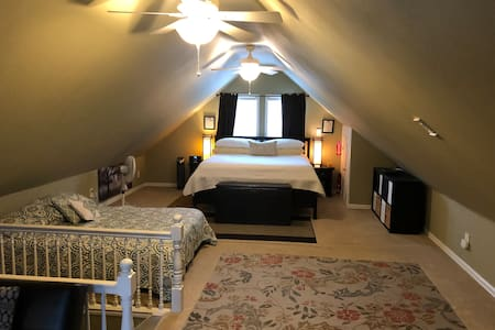 Full size loft, king bed, queen bed and bathroom.