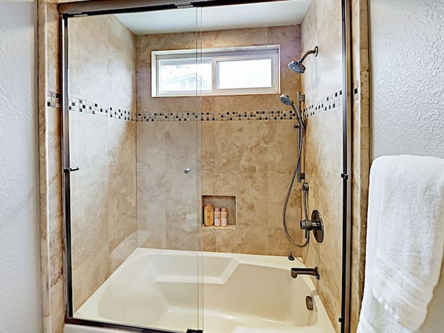 One of the guest bathrooms is equipped with a tub/shower combination