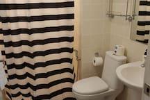 Bathroom with spacious shower area