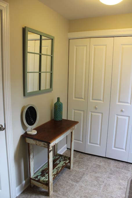 Bright entryway into the apartment furnished with local pieces.