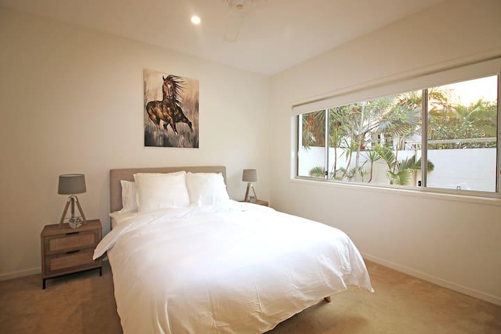 Downstairs queen bedroom with built-in wardrobe.