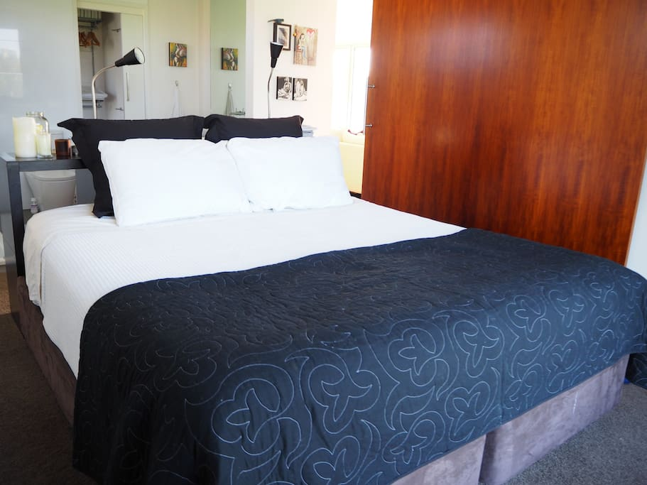 Firstly, your room. Beautiful king bed with pillow top