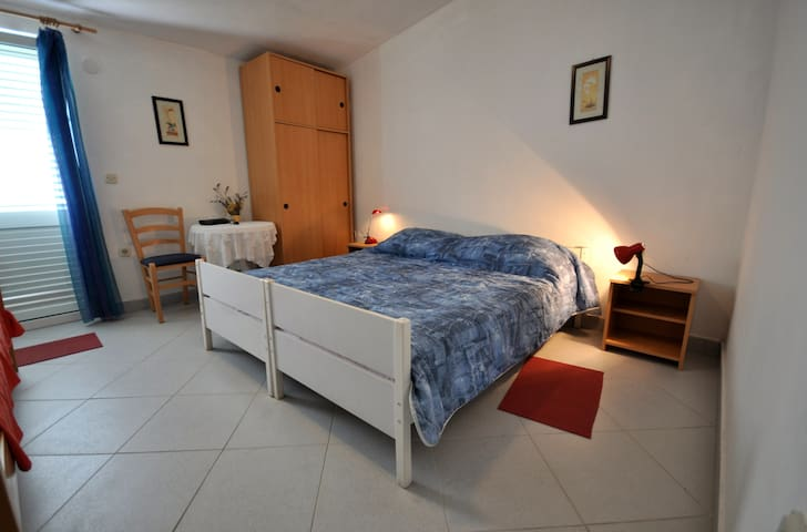 2nd bedroom offers double bed and single bed.