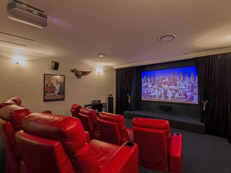 Gold class theatre with recliner seating for 8 and floor space for more