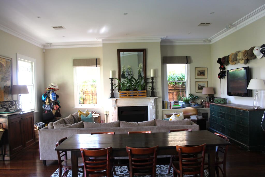 View from Kitchen Bench across dining table to fireplace .