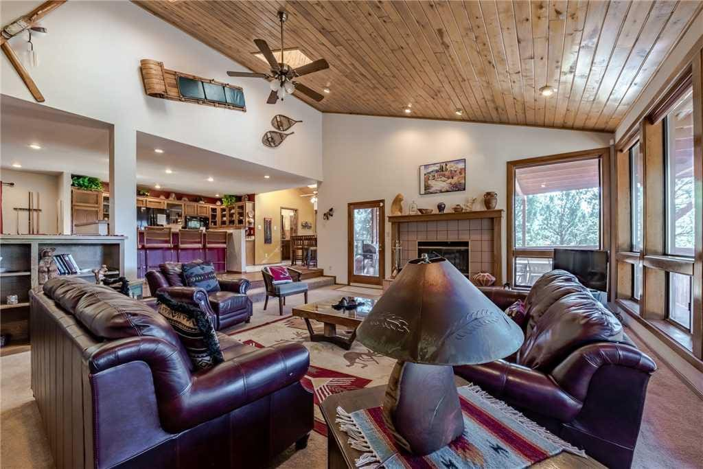 Vaulted ceilings and an open floor plan add to the ambiance of this fantastic property.
