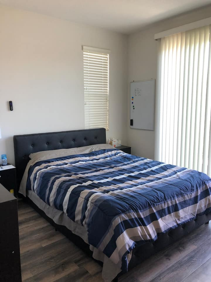 Comfortable bedroom full kitchen and smart TV