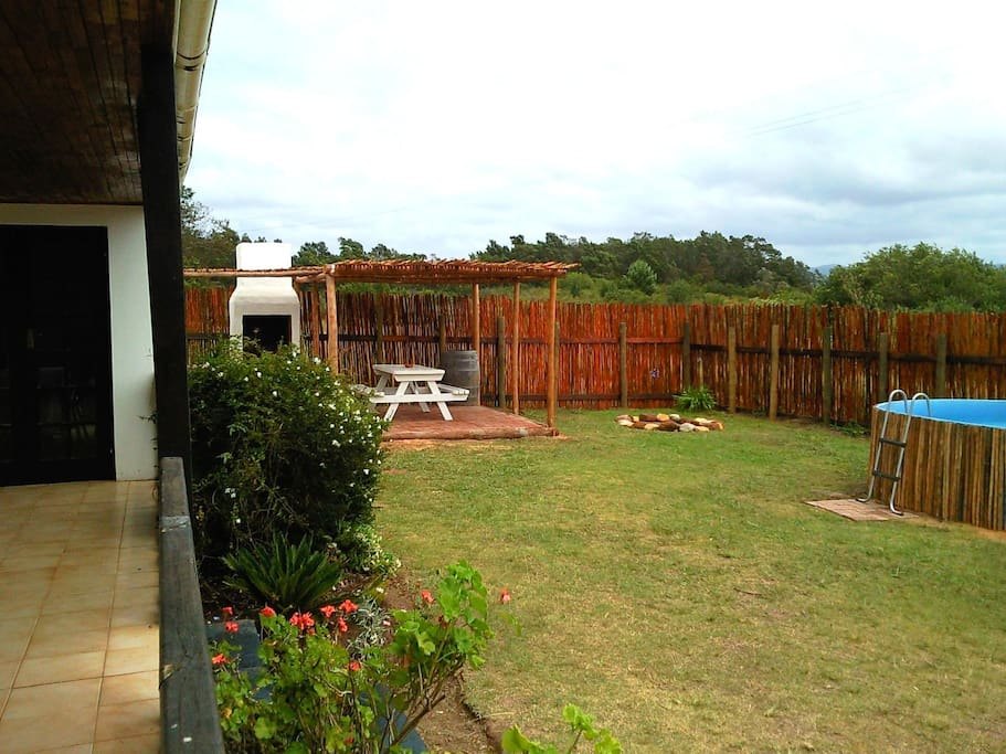 Protea Cottage private garden with splashpool, boma firepit and bbq area.
