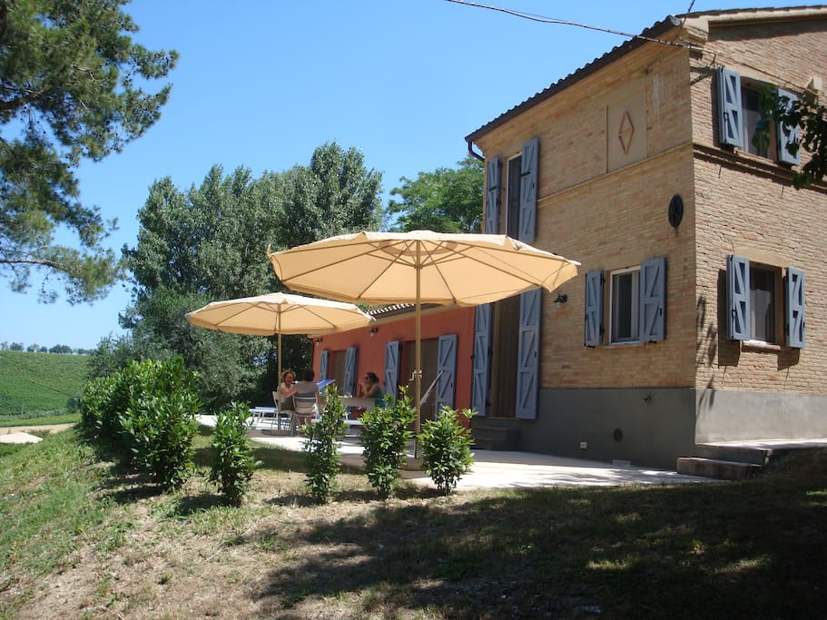 Terrace for meals in the shade of umbrella's. Kitchen opens to kitchen