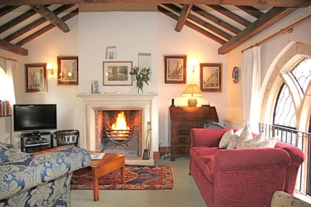 Vaulted and beamed upstairs living space  with open fire