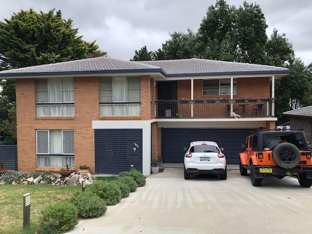 Street view of house. Unit is bottom left of front door.