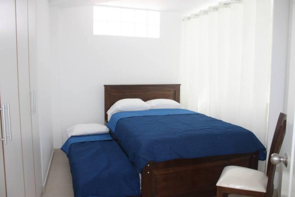Dormitorio Principal (1 cama 2 plz y 1 cama corrediza de 1 plz.)
