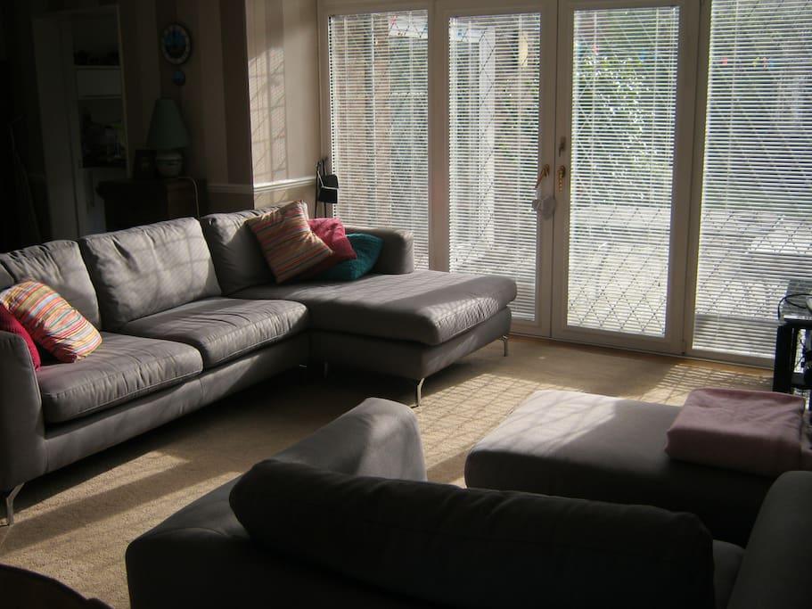 Spacious lounge with corner sofa and love seat