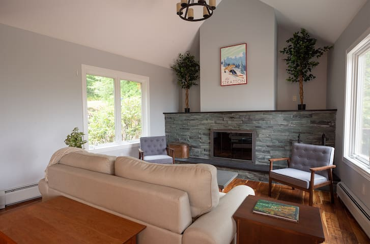 A large opening stone fireplace beckons guests for deep conversation and board games. Pull out bed/sofa. MAIN FLOOR