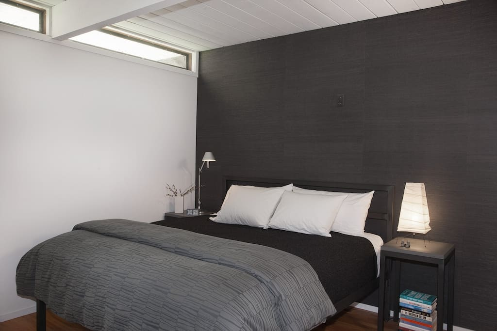 Master bedroom with built-in closet, en-suite bathroom, TV (limited channels) and USB charging station.