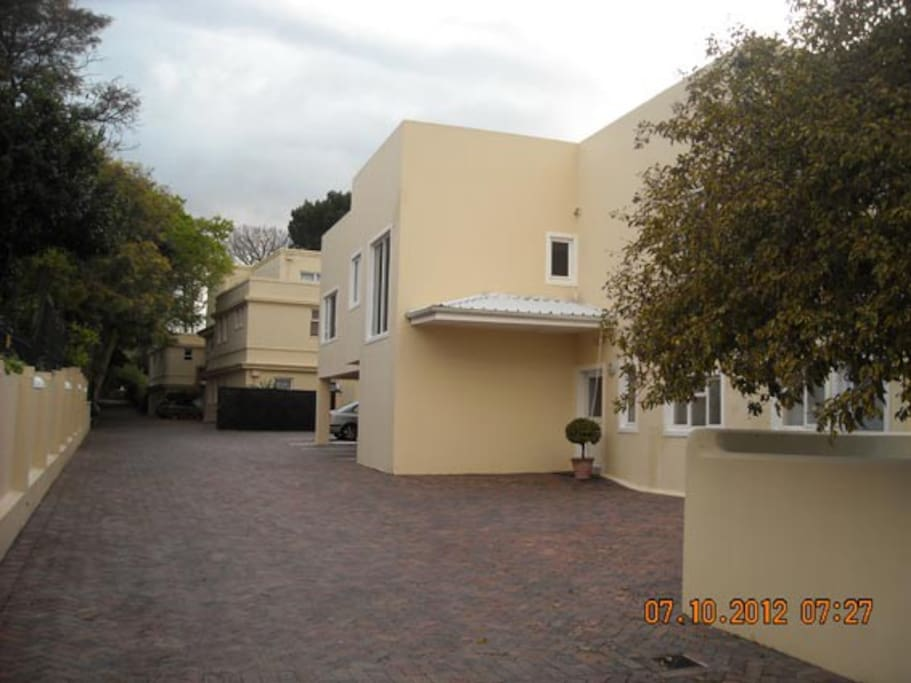 The apartment is on the ground floor - entrance first door behind pepper tree