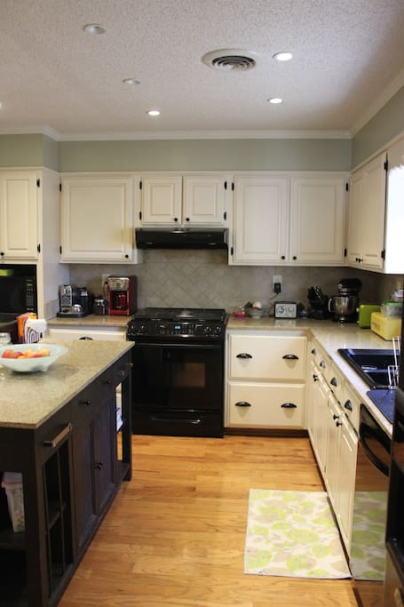 Fully stocked kitchen with gas stove