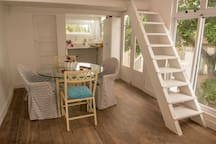 Dining, kitchen & stair to bedroom