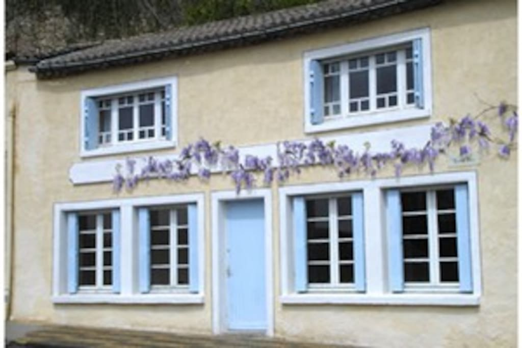 Pretty wisteria clad Petite Maison Bleue with large light filled rooms.