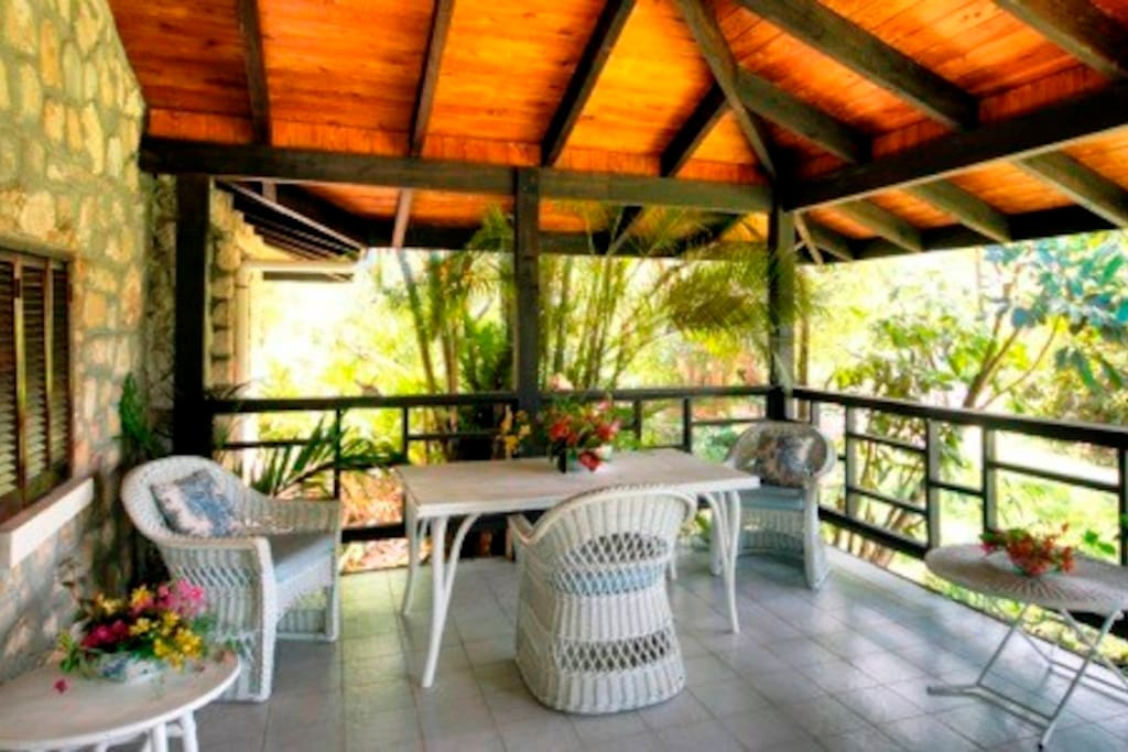 Covered deck - use as a dining space or for swinging on your hammock
