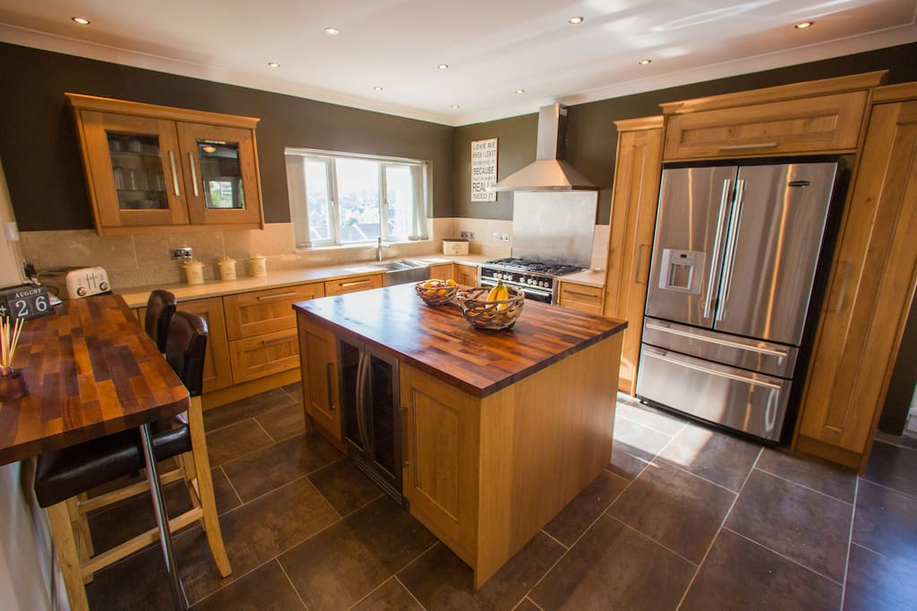 Quartz countertop and wooden island. Stainless steel appliances.