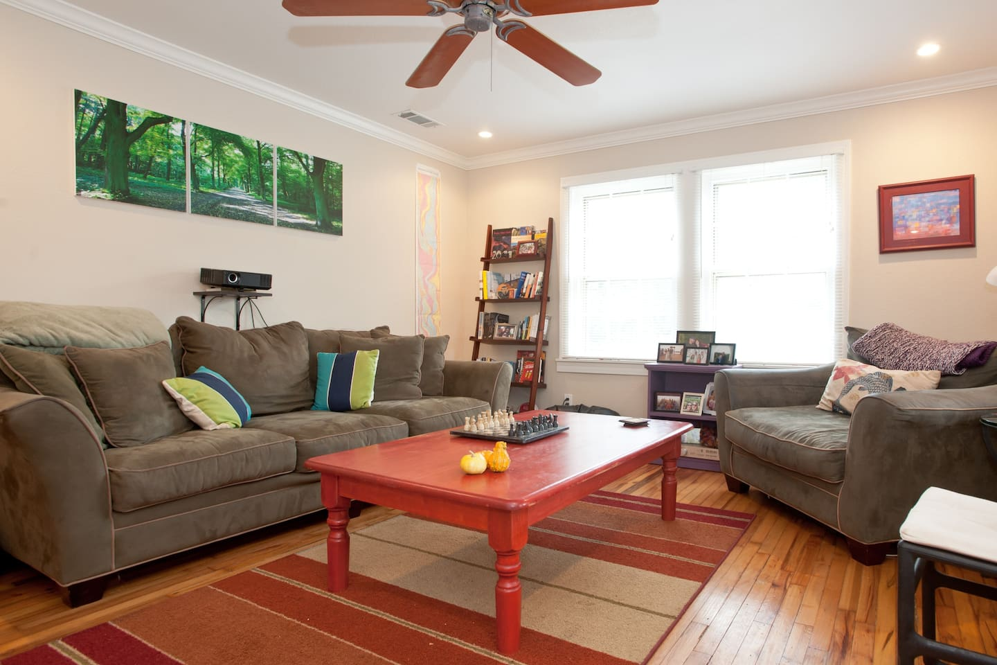 The cozy living room: feel free to read a book, play chess, watch movies on the projector or just lounge around!