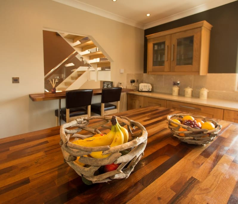 Modern kitchen with wooden island and bar also lots of nice upgrades.
