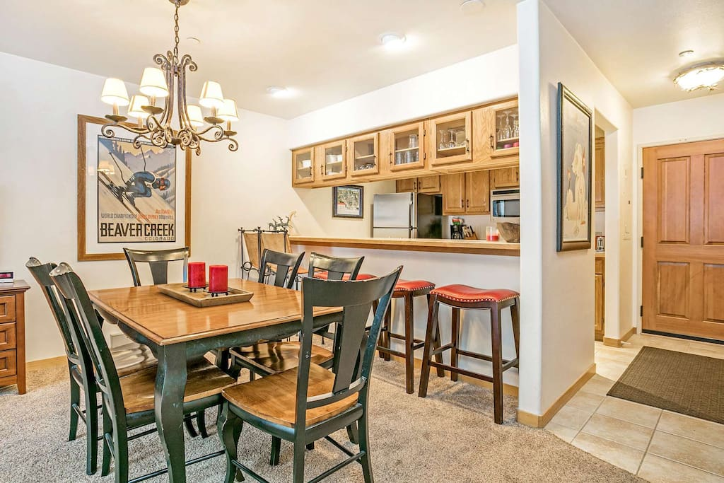 Belly up to the breakfast bar or enjoy a meal at the roomy dining table.