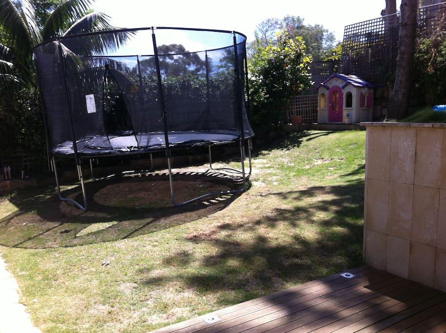 Kids paradise backyard with trampoline