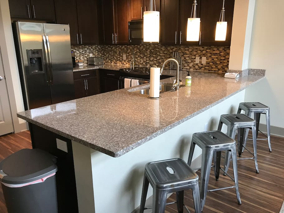 Great open kitchen with a large bar top counter, stainless steel appliances, and every kitchen amenity you could ever want!