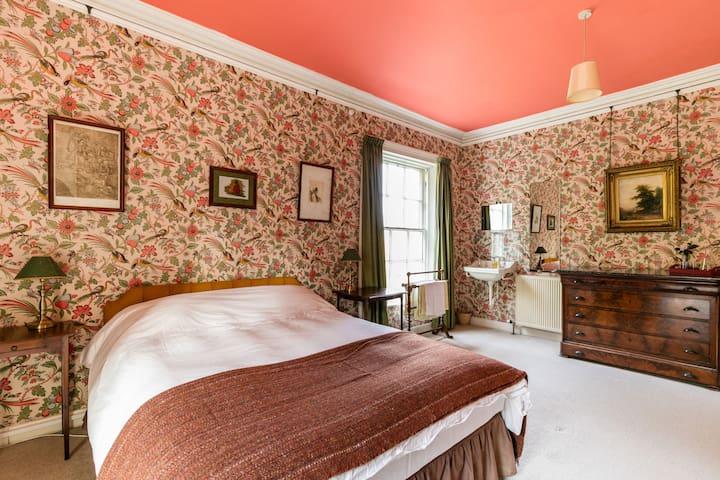 Elegant double room in 1820s residence.
