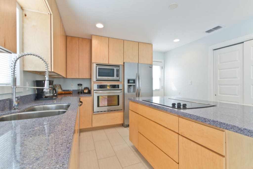 Open kitchen with large center island and plenty of natural lighting