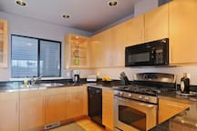 This bright and spacious kitchen has everything you need.   Gas range with convection oven, quiet Bosch dishwasher, stainless steel refrigerator, with bottom freezer drawer and garbage disposal.   Counter is outfitted with blender, toaster and coffee make