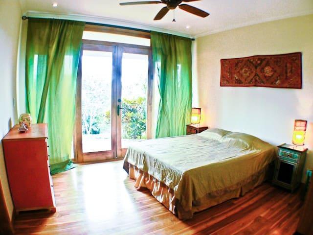 Bedroom #1 - Downstairs Suite, King bed.