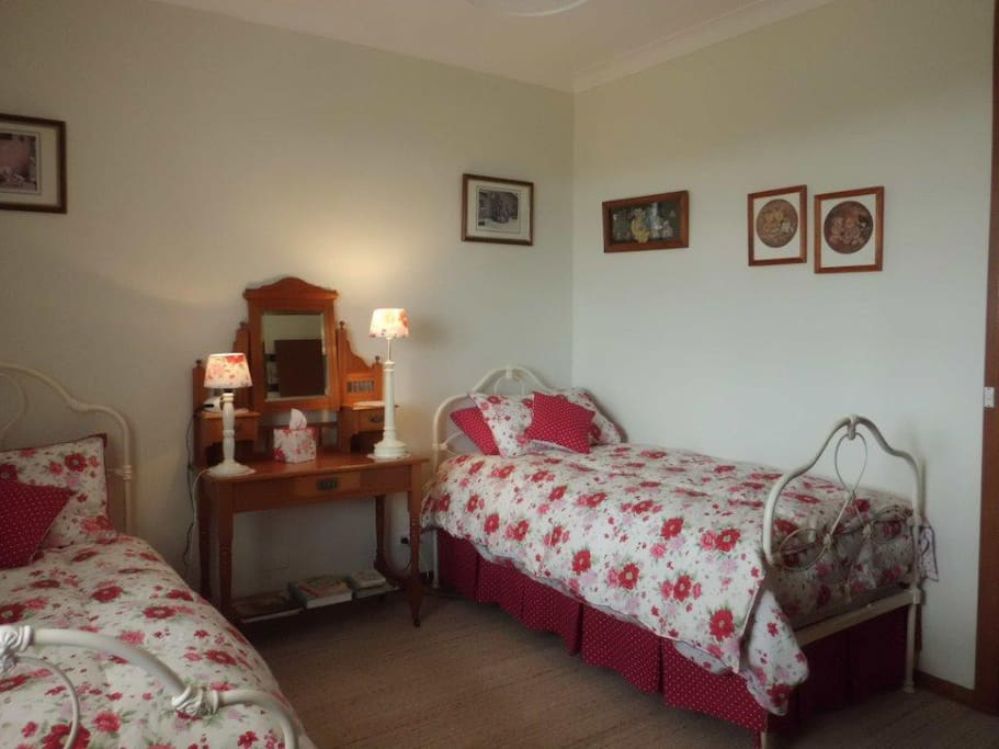 Twin bedroom has Laura Ashley furnishings. Electric blanket on beds