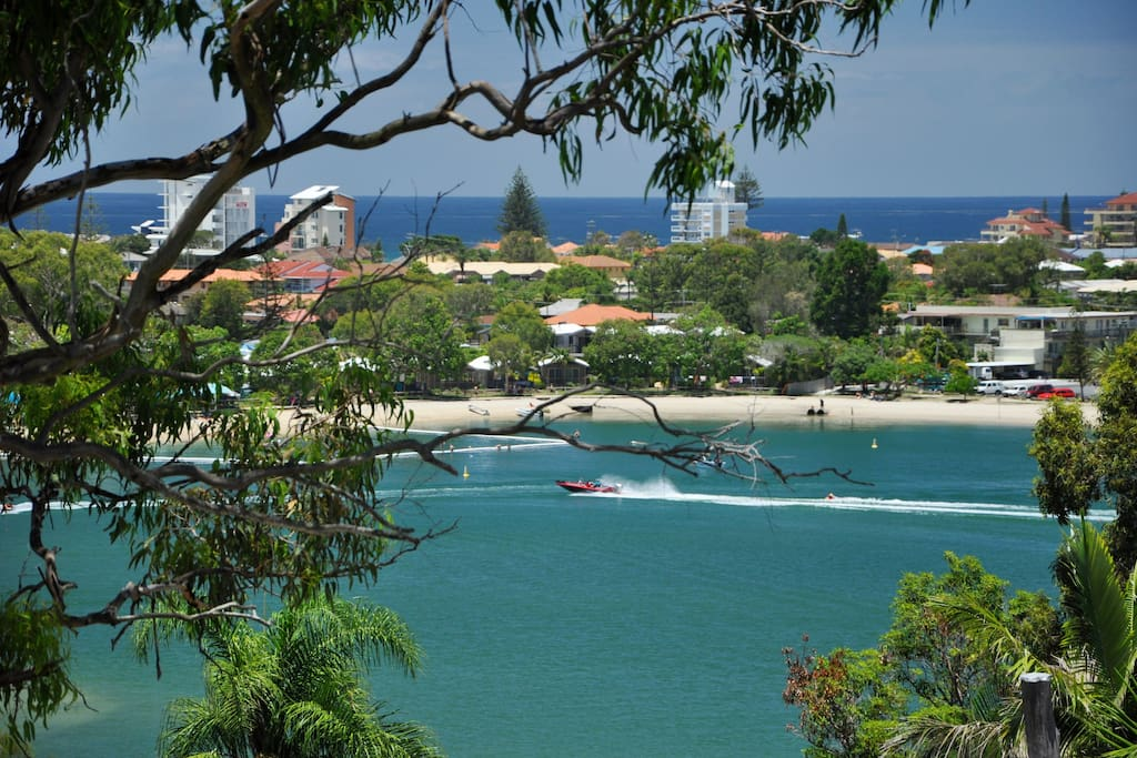 The view to the Coral Sea over Tallebudgera Creek .