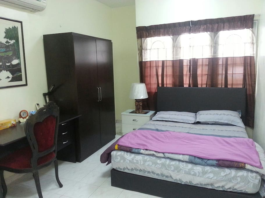 A spacious Master bedroom for two pax with an attached bath.