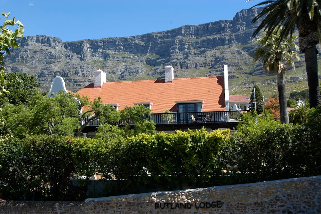 This 1904 Herbert Baker Cape Dutch Manor House is located on a quiet tree-lined street on the slopes of Table Mountain overlooking the city of Cape Town and Table bay.