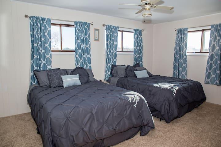 Bedroom 1 with 2 queen beds
