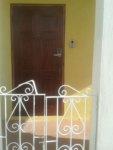 Smart lock and door bell at entrance to Studio Apartment