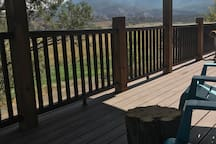 Enjoy your coffee or wine on our front deck with our other guests or us.