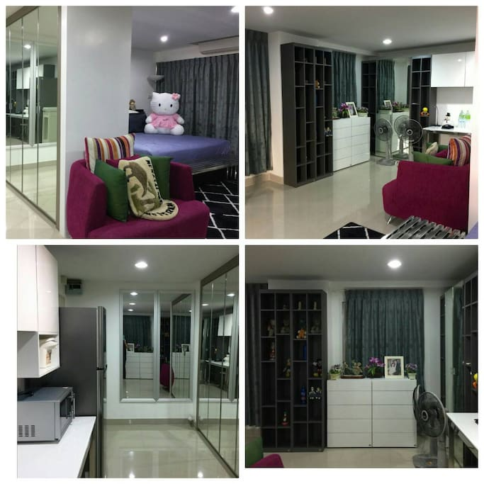 Super big wardrobes  colorful sofa , long working desk and fully home entertainment unit.