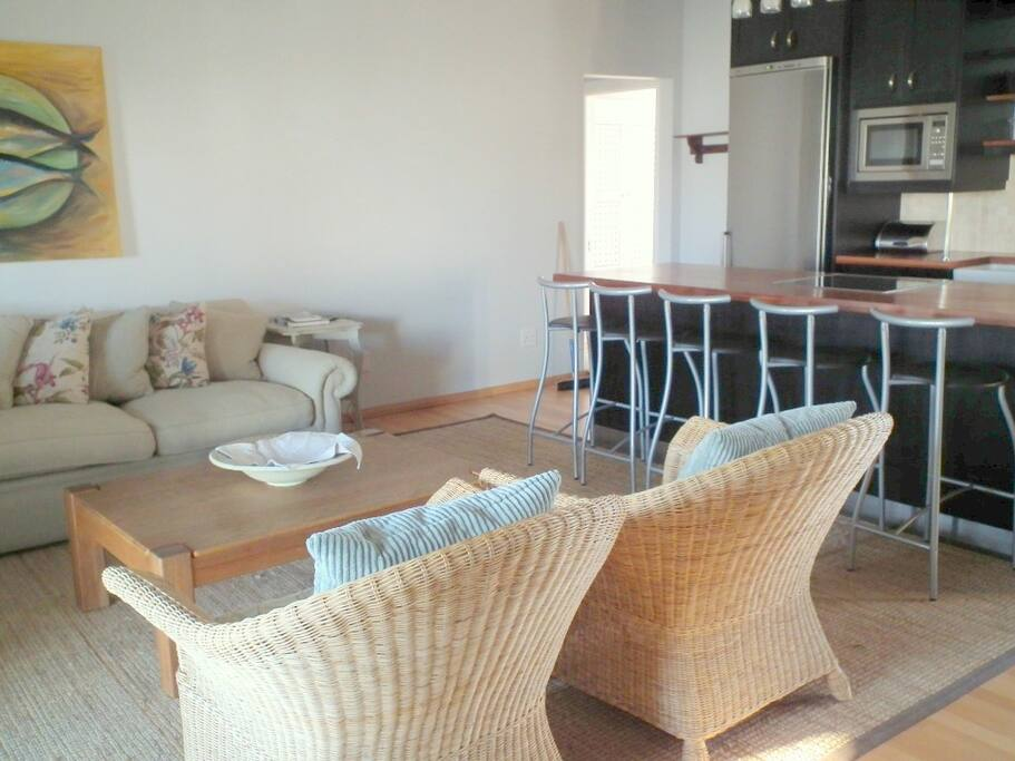 Open plan lounge/kitchen with full DSTV