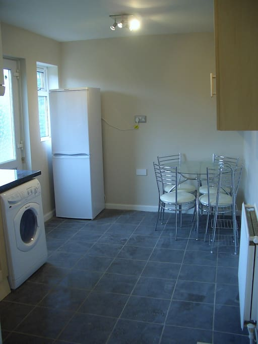 Dining area with washer & dryer