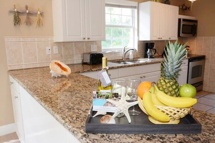 Villa Chez Shell's spacious kitchen has granite counters, a ceramic top stainless steel range/oven, microwave, garbage disposal, dishwasher and large refrigerator/freezer. The cabinets are fully stocked with everything a chef may need.