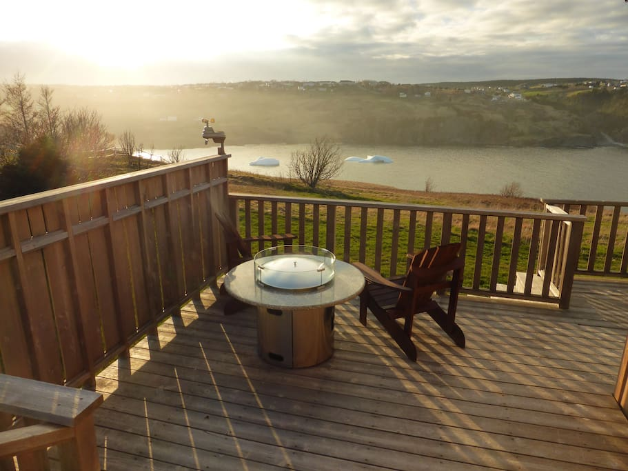 Deck with propane firepit table and view of icebergs (seasonal)