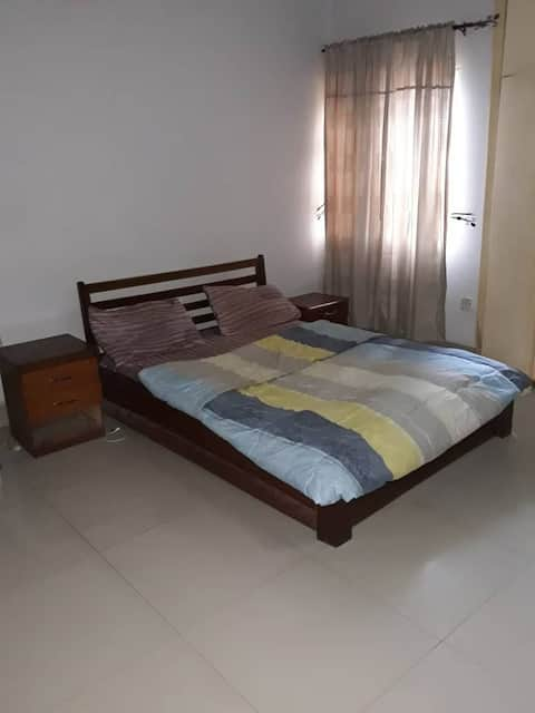 Private room and bathroom in spacious Abuja home