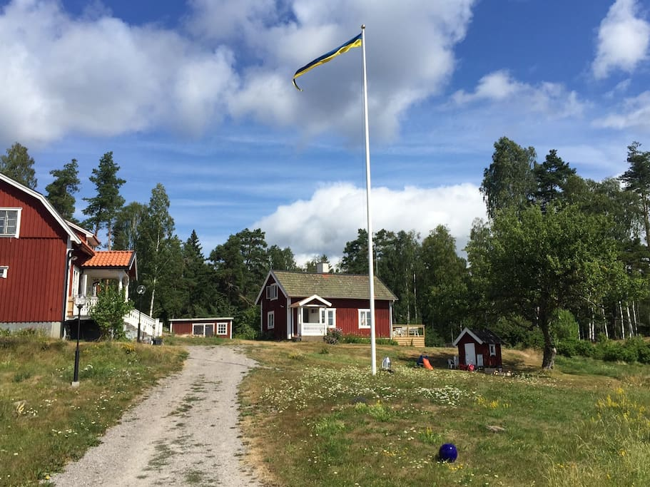 Cottage to the right and the main house to the left where the host family live.