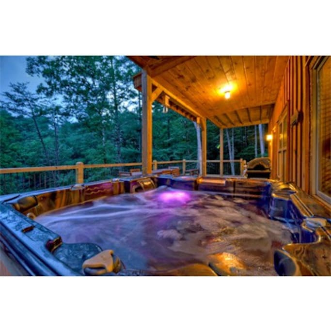 Gorgeous hot tub with color changing lights overlooking your private woods
