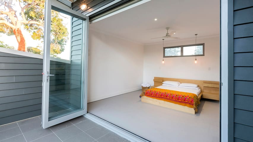 Upstairs master bedroom with private balcony.